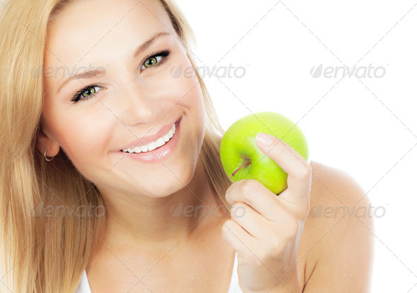 Pretty girl eating apple - Stock Photo - Images