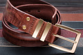 Brown men leather belt with golden buckle