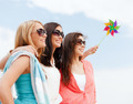 girls with windmill toy on the beach - PhotoDune Item for Sale