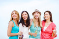 girls with drinks on the beach - PhotoDune Item for Sale
