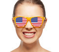 happy teenage girl in shades with american flag - PhotoDune Item for Sale