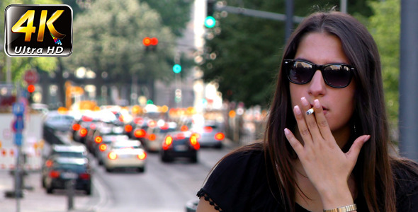 VideoHive Woman Smoking and Traffic Behind in City 11860003