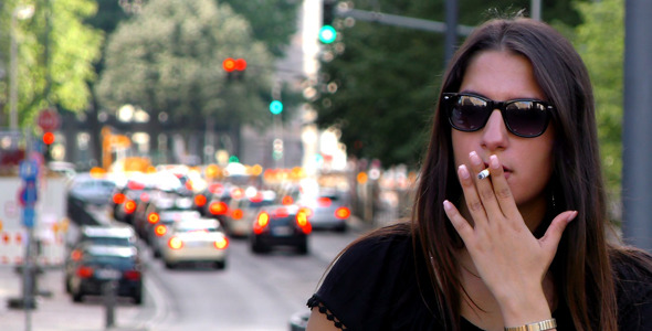 VideoHive Woman Smoking and Traffic Behind in City 11860020