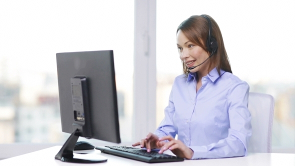 Female Helpline Operator With Computer At Office