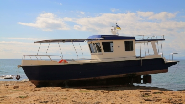 Big Sailboat Standing On The Seashore
