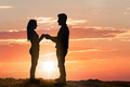 Silhouette Of Young Couple At Sunset - PhotoDune Item for Sale