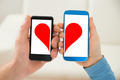 Couple Holding Cellphone With Half Heart Symbol - PhotoDune Item for Sale