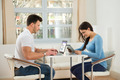 Young Couple Using Digital Tablet And Laptop - PhotoDune Item for Sale