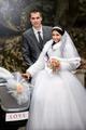 groom with the bride near the wedding car