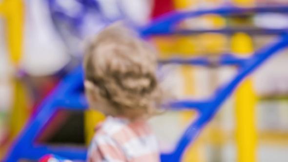 VideoHive Baby Boy Running In Playground 11885155