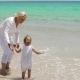 Grandmother And Little Girl Enjoying At The Beach - VideoHive Item for Sale