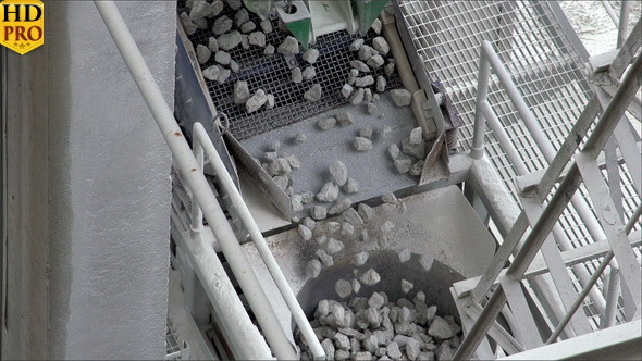 Rocks Slowly Dropping from a Conveyor