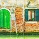 Old green iron door over a canal in Venice, Italy. - PhotoDune Item for Sale