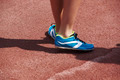 Jumping sport shoes in the athletic field ground. Horizontal