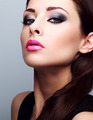 Beautiful woman with bright smokey makeup eyes and pink lipstick