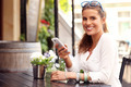 Happy woman using smartphone in cafe - PhotoDune Item for Sale
