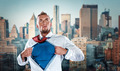 businessman acting like  super hero and tearing his shirt off