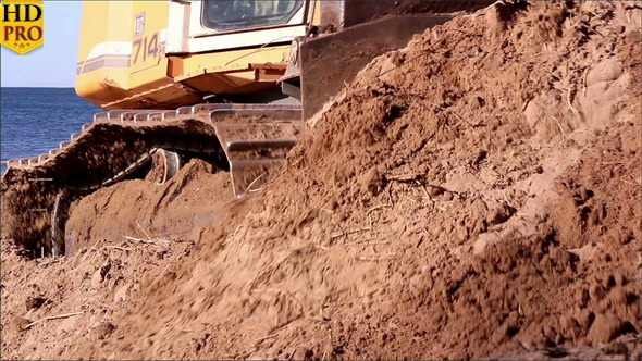 Brown Soil being Pushed by the Bulldozer