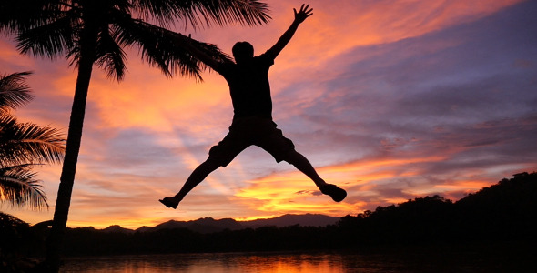Man Jumping In Sunset