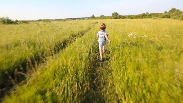 Boy Running In a Park Or Garden