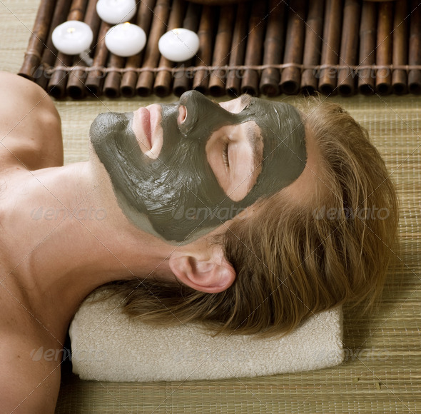 Spa. Handsome Man With A Mud Mask On His Face - Stock Photo - Images