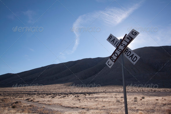 Railroad crossing tracks in the desert - Stock Photo - Images