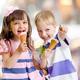 happy kids eating ice cream on nice bokeh background - PhotoDune Item for Sale