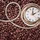Retro clock on a coffee background - PhotoDune Item for Sale