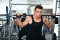man doing exercises dumbbell buttocks muscles