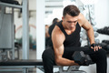 man doing exercises dumbbell bicep muscles