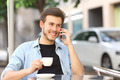Man talking on the mobile phone in a coffee shop - PhotoDune Item for Sale