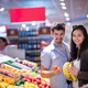 couple shopping in a supermarket - PhotoDune Item for Sale
