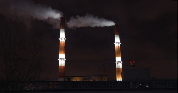 Smoking Factory Pipes In The City At Night