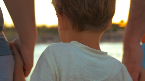 VideoHive Boy Taking Parents Hands 11944362