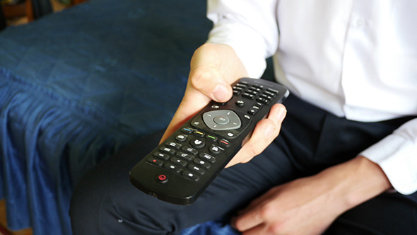 Male Hand Changing Channels On TV
