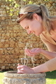 Woman drinking water on a public fountain bubbler - PhotoDune Item for Sale
