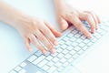 Female hands or woman office worker typing on the keyboard - PhotoDune Item for Sale