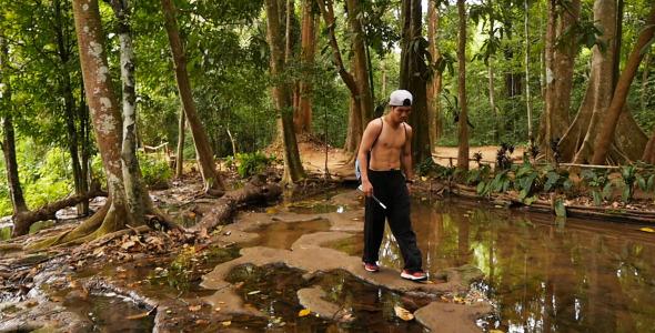 Asian Man Walking In Nature