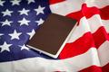 Passport on an American flag - PhotoDune Item for Sale