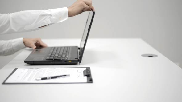 Businessman Opening Laptop and Typing