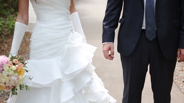 Wedding Theme Holding Hands Newlyweds