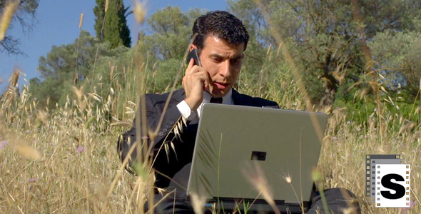 Businessman Working In The Field