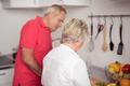 Senior Couple Preparing Fresh Food at the Kitchen - PhotoDune Item for Sale
