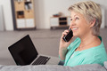 Happy Woman with Laptop Talking on Phone - PhotoDune Item for Sale