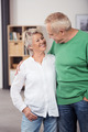 Happy Senior Couple Smiling and Hugging Each Other - PhotoDune Item for Sale