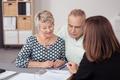 Senior Couple Listening to Business Agent Talking - PhotoDune Item for Sale