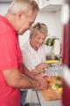 Wife Watching her Husband Slicing Food Ingredients - PhotoDune Item for Sale