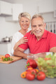 Matured Couple at the Kitchen Smiling at Camera - PhotoDune Item for Sale