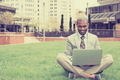 Handsome happy businessman working with laptop outdoors - PhotoDune Item for Sale