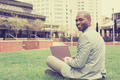 Handsome businessman working with laptop sitting outdoors - PhotoDune Item for Sale